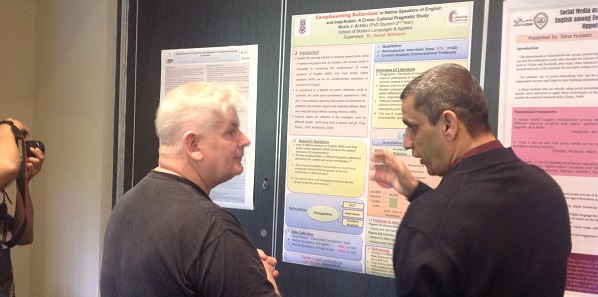 Mazin Al-Hilu discuss his research with Prof. Eoin Devereux, Assistant Dean for Research