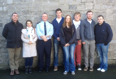 Photograph of students, Ger Coffey and a member of An Garda Síochána at Limerick Prison.