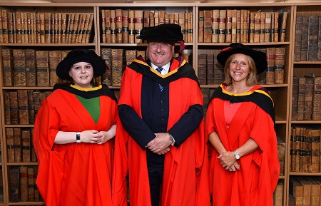 THE SCHOOL OF LAW CELEBRATES FOUR PHD GRADUATES Conferring Ceremony