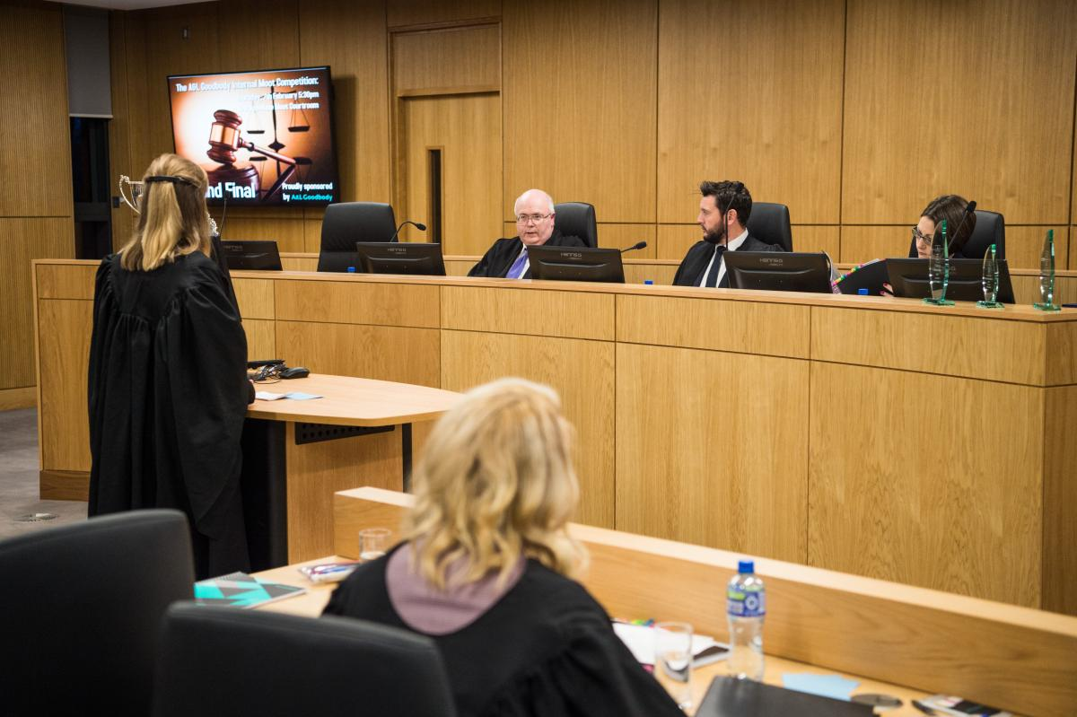 The moot courtroom in session with seated judges and students in official robes