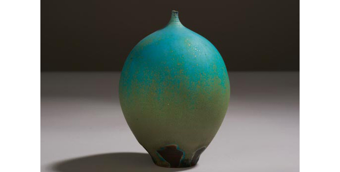 CR32 IACI.2002.241 Cabat Vase Small ceramic vase, (Inscribed on base, Cabat). Ivory coloured clay glazed with a dark terracotta slip and thickly over-glazed turquoise blue and golden green. The vase is a vertical egg shape finishing with a tiny stemmed aperture two millimetres wide. 12.2 x 7.9 x 7.9 cms United States Ceramic
