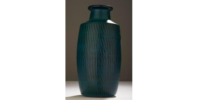 CR41 IACI.2002.286 Gnylund Nymolle Vase Raw umber coloured clay, over glazed light cobalt and blue viridian. The exterior is patterned vertically with raised wave patterns. The top lip is flanged out and undecorated. The interior is glazed similarly to the exterior. (Inscribed on base, G. Nylund, 5076, N Nymolle, Denmark) 28.1 x 13.6 x 13.6 cms Denmark Ceramic