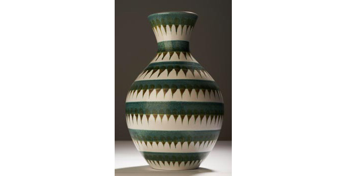 CR48 IACI.2002.285 Stig Lindberg Vase Off centred, terracotta, white under glazed throughout, over painted with seven horizontal bands of olive green tear drop shapes, over which are printed seven bands partially covering the tear drop forms. (Stamped with company logo and Sweden, 0.46.138 W) 26.7 x 17.4 x 17.4 cms Sweden Ceramic